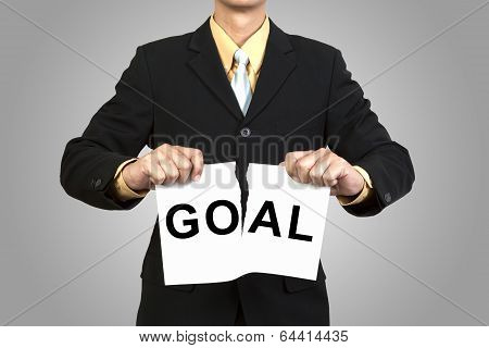 Businessman Tear Paper With Word Goal