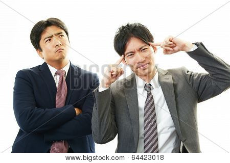 Frustrated Asian businessmen