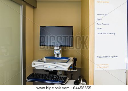Computer for electronic medical records access in patient hospital room.  White board for medical personnel to note such information as patient's doctor, nurse, instructions, and expected discharge date. poster