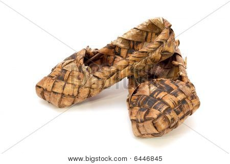 Russian Bast Shoes On A White Background
