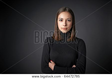 Closeup portrait of young female in black pullover