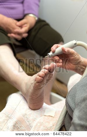 Chiropodist At A Senior Woman