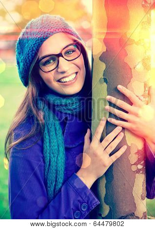 nice girl hugging a tree
