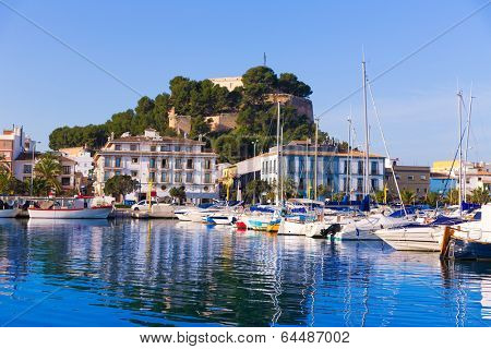 Denia Port with castle hill and marina boats in Alicante province Spain poster