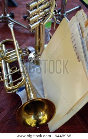 2 Trumpets And A Folder Of Sheet Music