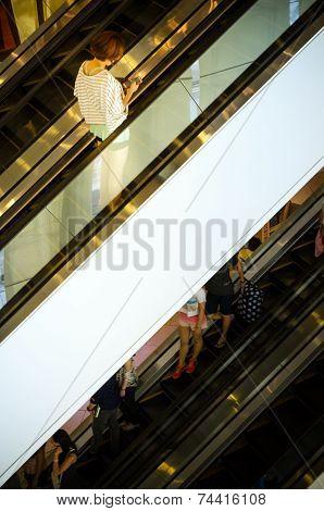 Bangkok, Thailand - September 12, 2013: Shoppers On Escalator At Terminal21
