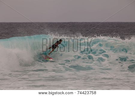 Young Surfer Crashing In The Wave