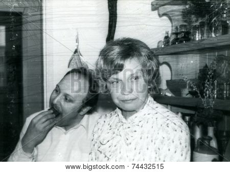 Vintage photo of man and woman during a family party, seventies