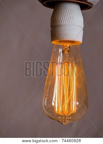 energy saving lamp, symbol photo for energy saving, ecology, environmental protection. filament of a gl���¼hbrine
