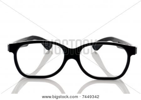 A Pair Of Black Framed Nerdy Eye Glasses On A White Reflective Surface
