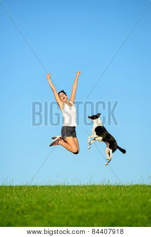 Sporty Woman And Dog Jumping