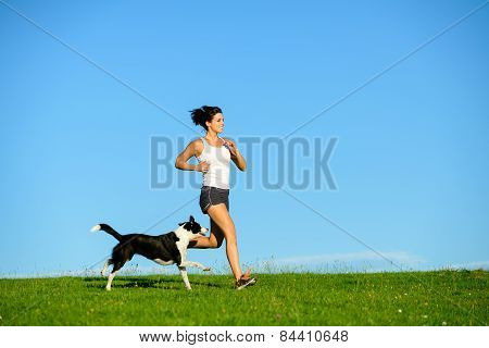 Sporty Happy Woman Running With Dog Outdoor