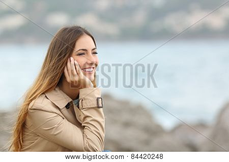 Happy Woman Thinking And Looking Away On The Sea