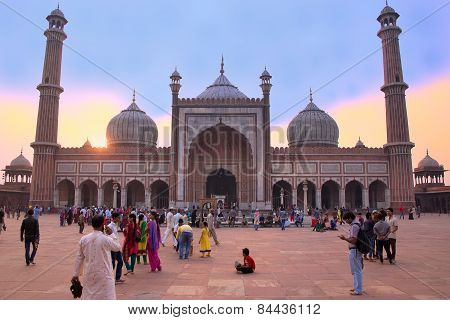 Delhi, India - November 5: Unidentified People Walk In The Courtyard Of Jama Masjid At Sunset On Nov