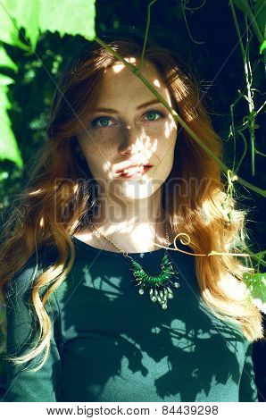 Beautiful Young Woman With Auburn Hair And Green Eyes