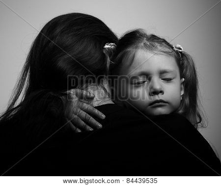 Depression Daughter Hugging Her Mother With Sad Face. Closeup Portrait