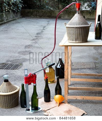 Homemade Wine Bottling In The Backyard With The Carboy