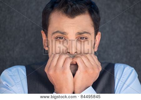 Man Biting Fingernails