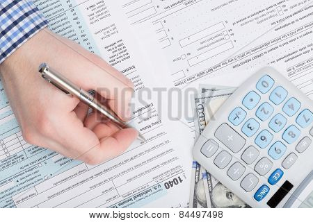 Taxpayer Filling Out Usa 1040 Tax Form