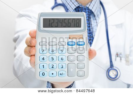 Doctor holding calculator in hand - health care concept poster