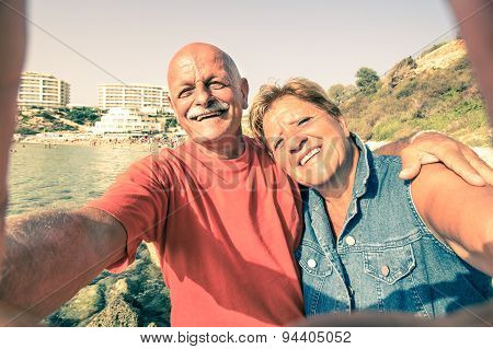Senior Happy Couple Taking A Selfie At Blue Grotto Resort In Malta South Coast - Adventure Travel