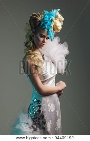 Studio Shoot Of Woman With Creative Hairstyle, Makeup And Dress. Exotic Bird
