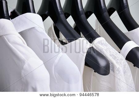 White Womens Clothing Hanging Close Up Horizontal