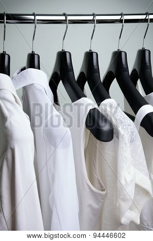 White Womens Clothing Hanging Side View Vertical