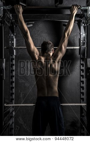 Bodybuilding, Athletic Man Pull-ups on Fitness Bar