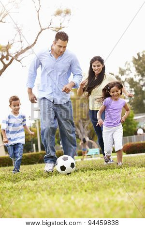 Hispanic Family Playing Soccer Together
