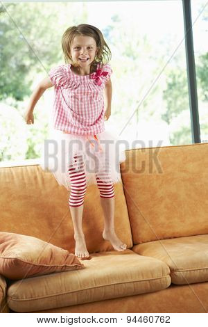 Young Girl Having Fun On Sofa