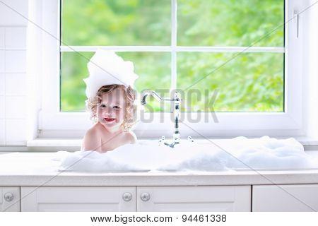 Baby Girl Taking Bath With Foam