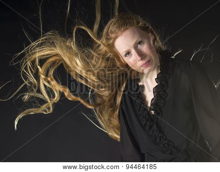 Woman with Wind Blowing Through Long Blond Hair