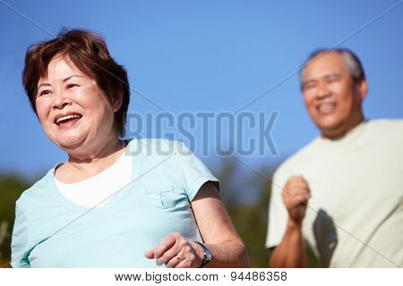 Senior couple jogging poster
