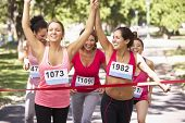 Group Of Female Athletes Completing Charity Marathon Race poster