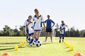 Group Of Children In Soccer Team Having Training With Coach poster