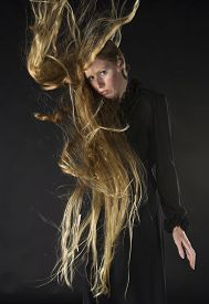 Blond Woman with Wind Blowing Through Long Hair