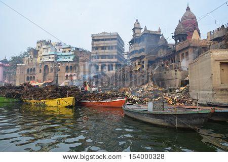 View of Varanasi city and cremation pyres from river Ganga, Varanasi, Uttar Pradesh, India