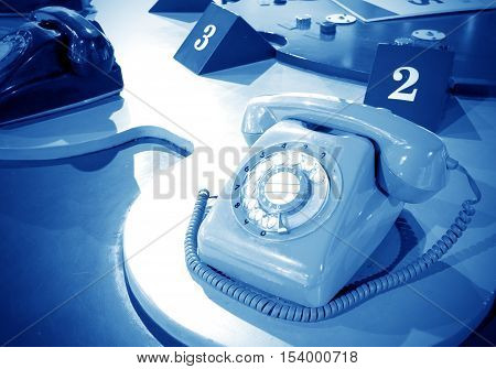 Sixties vintage rotary dial telephones,Blue hue map
