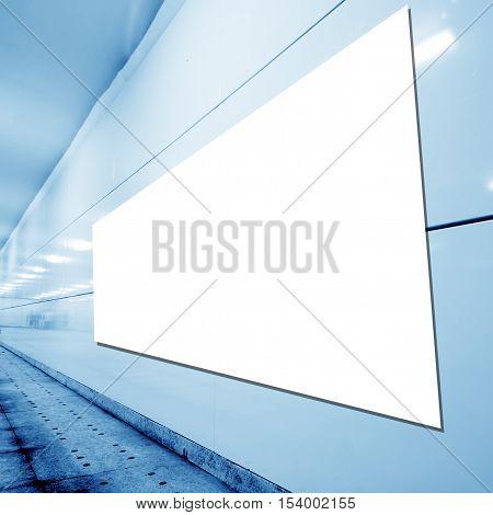 Blank billboards in the underground pedestrian passage.