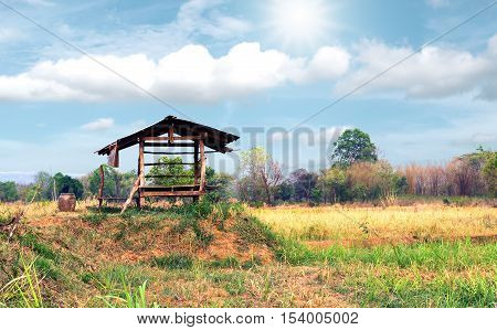 Vintage wooden cottage in the farm with beautiful sunlight and cloudsky.