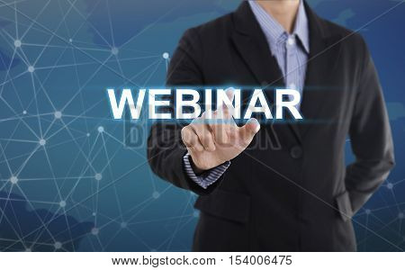 Businessman hand pressing button webinar. sign on virtual screen. business concept.