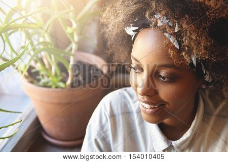 Beautiful Young African Student Girl Wearing Bandana Enjoying Free Time At Cafe After Classes At Uni