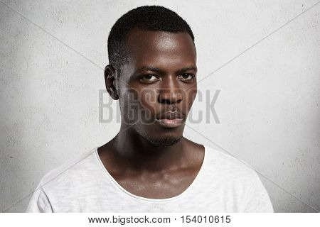 Portrait Of Confident And Handsome Young African Man Dressed Casually Looking At Camera With Serious