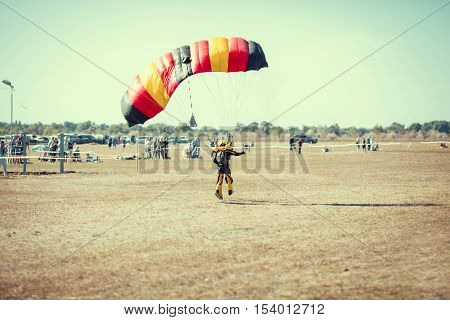 Parachute jumper on a wing parachute execute a controlled descent by parachute poster