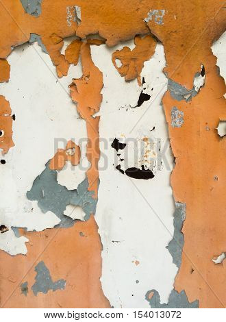 grungy wall texture with peeling paint and close upshot