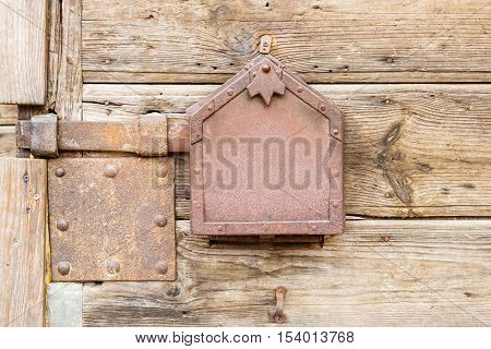 Old wooden doors locked with rusty metal latch