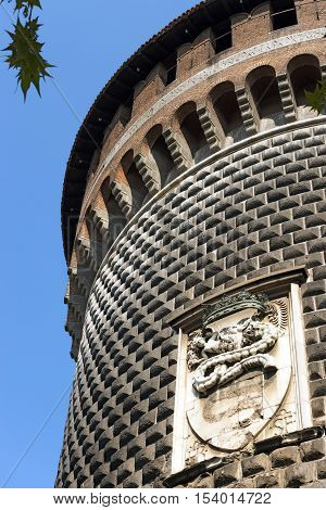 Torrione di Santo Spirito (Tower of Holy Spirit) with emblem of Sforza Family. Sforza Castle XV century (Castello Sforzesco). Milan Lombardy Italy
