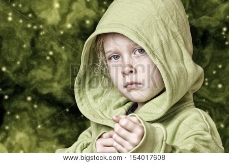 Portrait of a serious looking child girl on starfield background