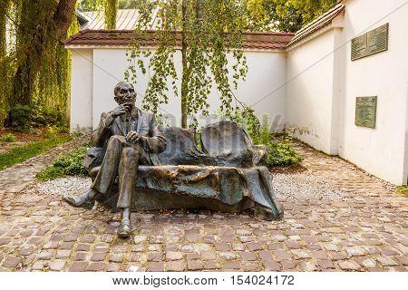 Krakow Poland - September 7 2016: Jan Karski bench in Kazimierz. Sculptor Karol Badyna. Jan Karski